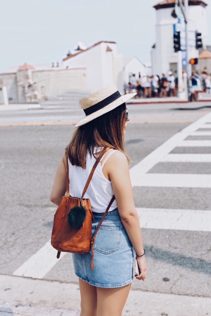 Simply Sona rocks a tan Madewell backpack while strolling through Malibu.
