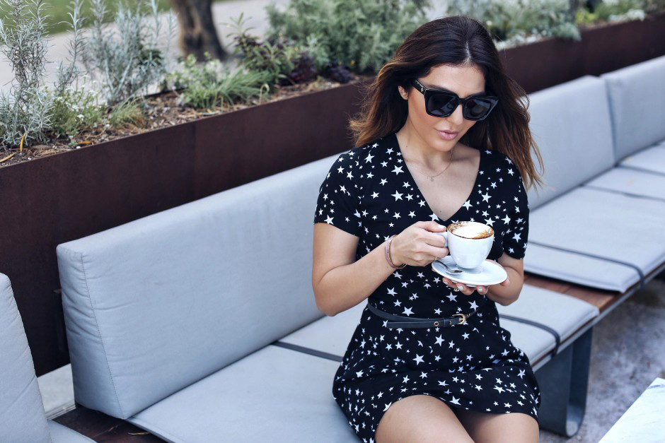 Sipping some coffee, Sona Gasparian shows off her favorite casual summer outfits.