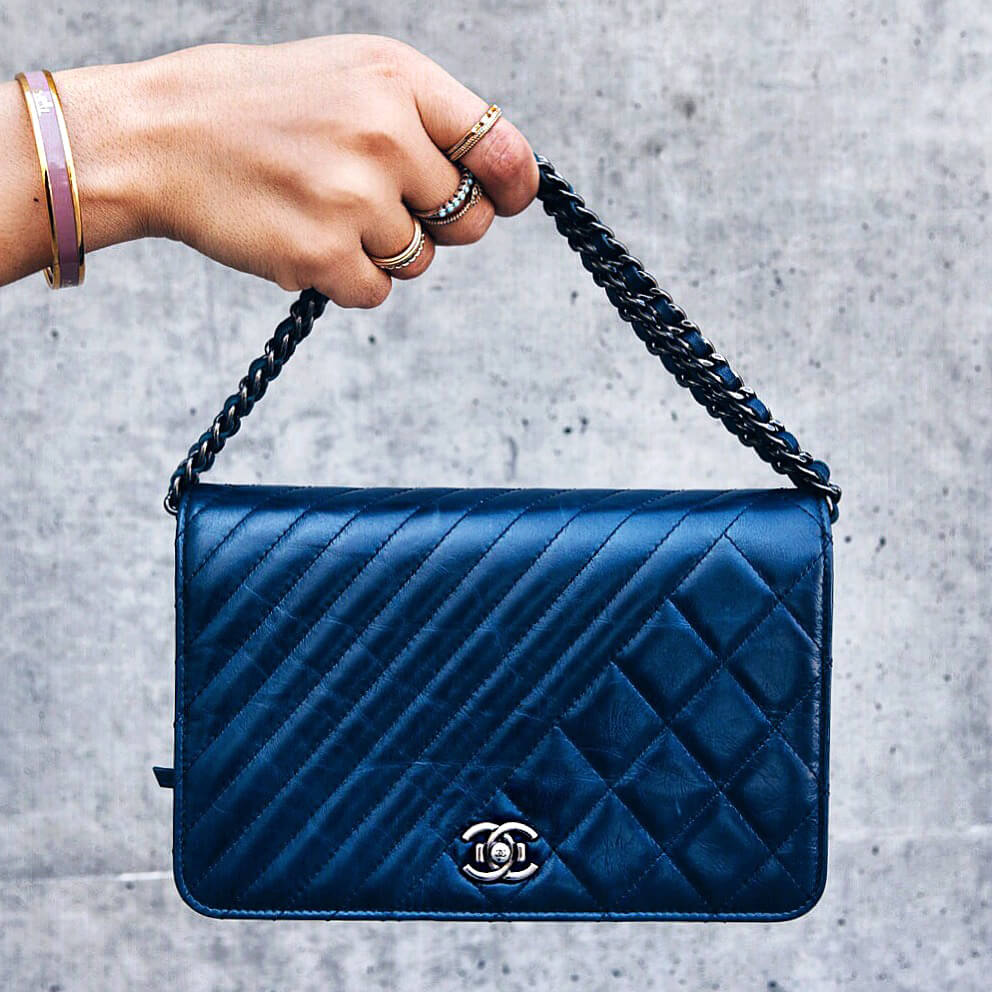 Chanel Purse's will always be in style. A smaller blue purse is perfect for a summer style look.