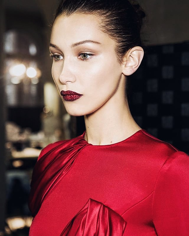 Bella Hadid wears Lust 004 in Vermillion Venom