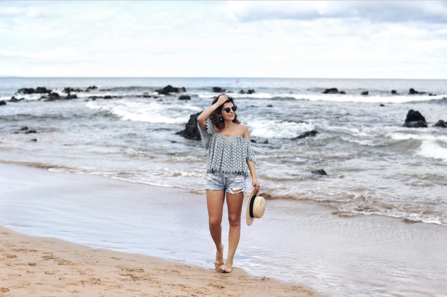 An off the shoulder top and shorts are a perfect beach look.