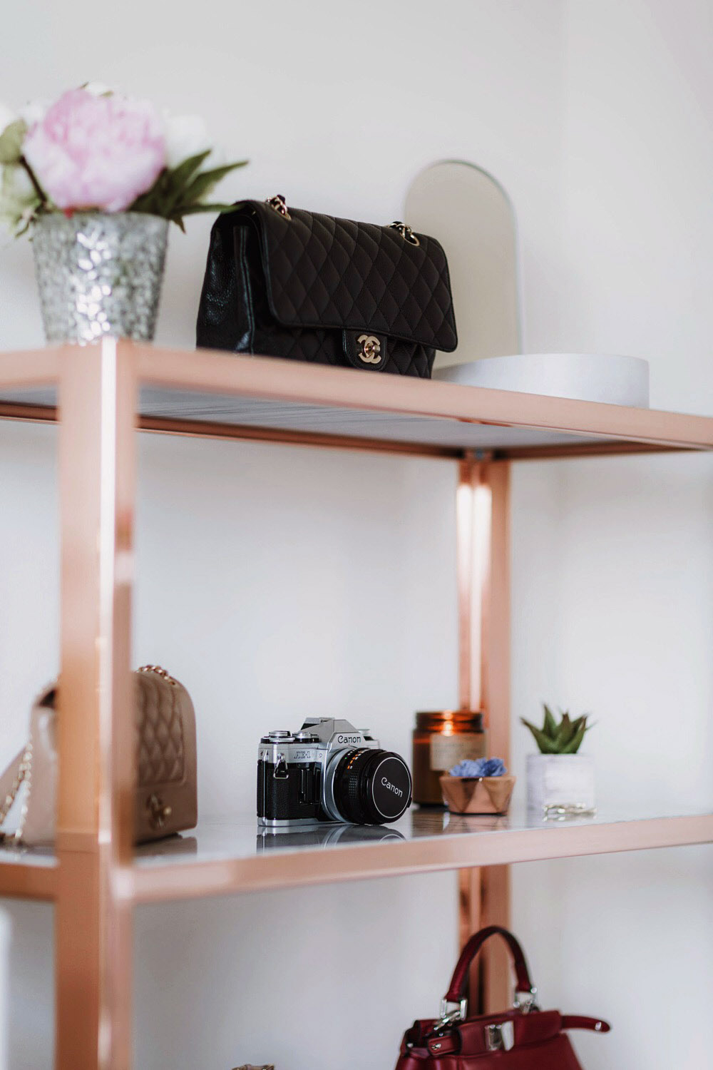 Rose gold shelf in my beauty room tour