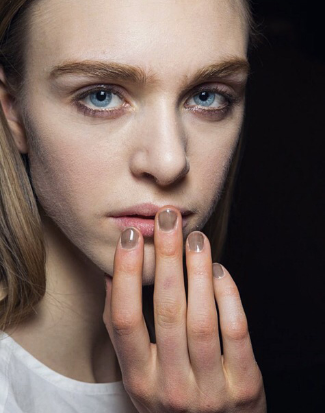 Earth tones in various shades of burnt orange, nudes and rust color are a fall nail polish trend.