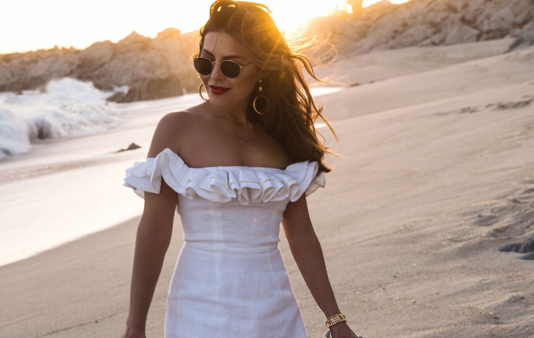 Sona Gasparian wears a little white dress that's perfect for summer while on vacation in Cabo