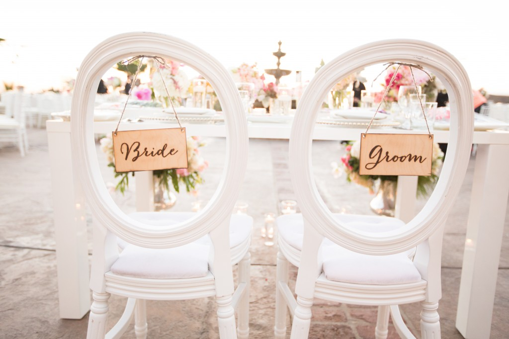 bride and groom chairs and sign