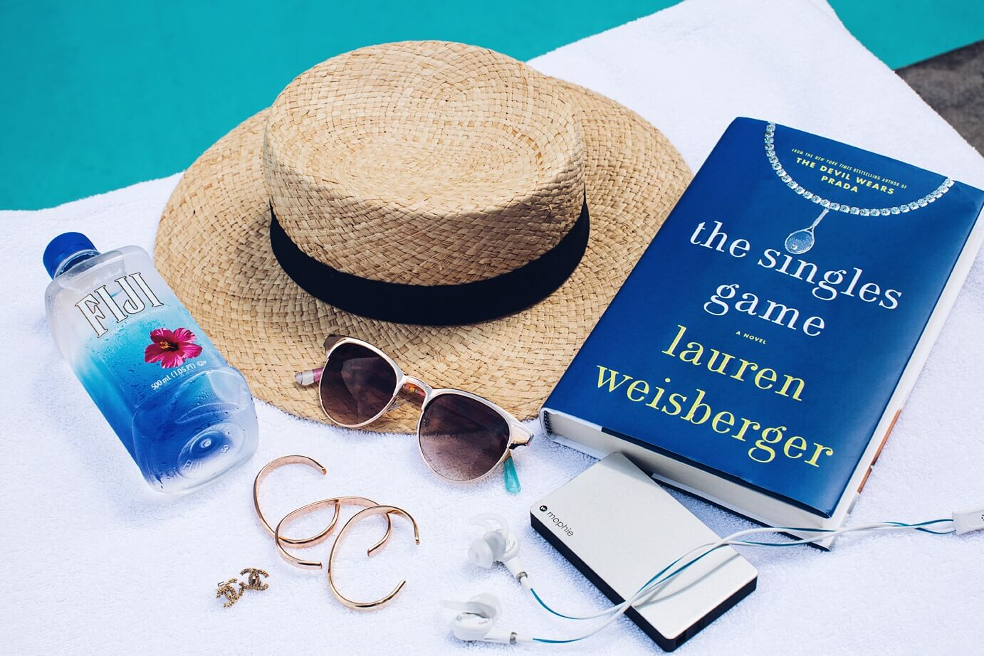 My Pool Side Beauty Survival Kit includes headphones, a cute hat, and sunglasses.