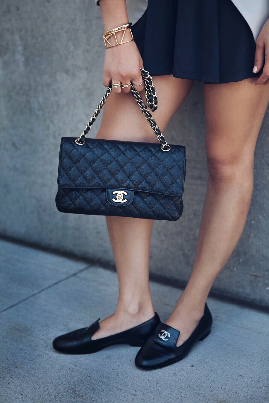 Sona Gasparian accessories her casual style with loafers and a chanel bag.
