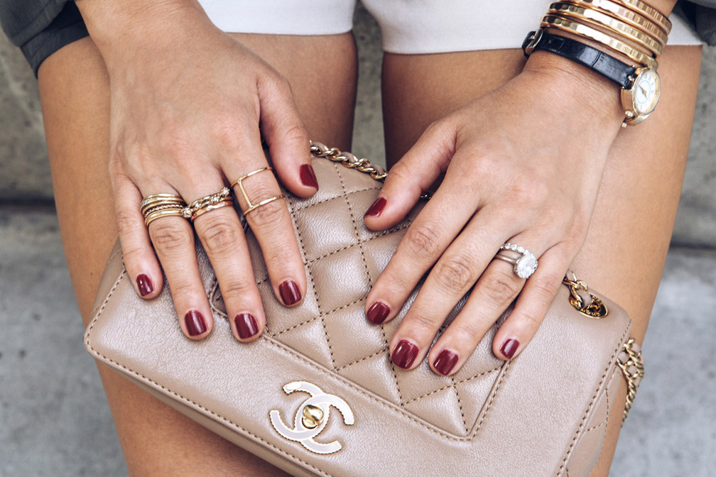 A Chanel purse and stacked jewelry worn to Sona Gasparian's LA meet up.