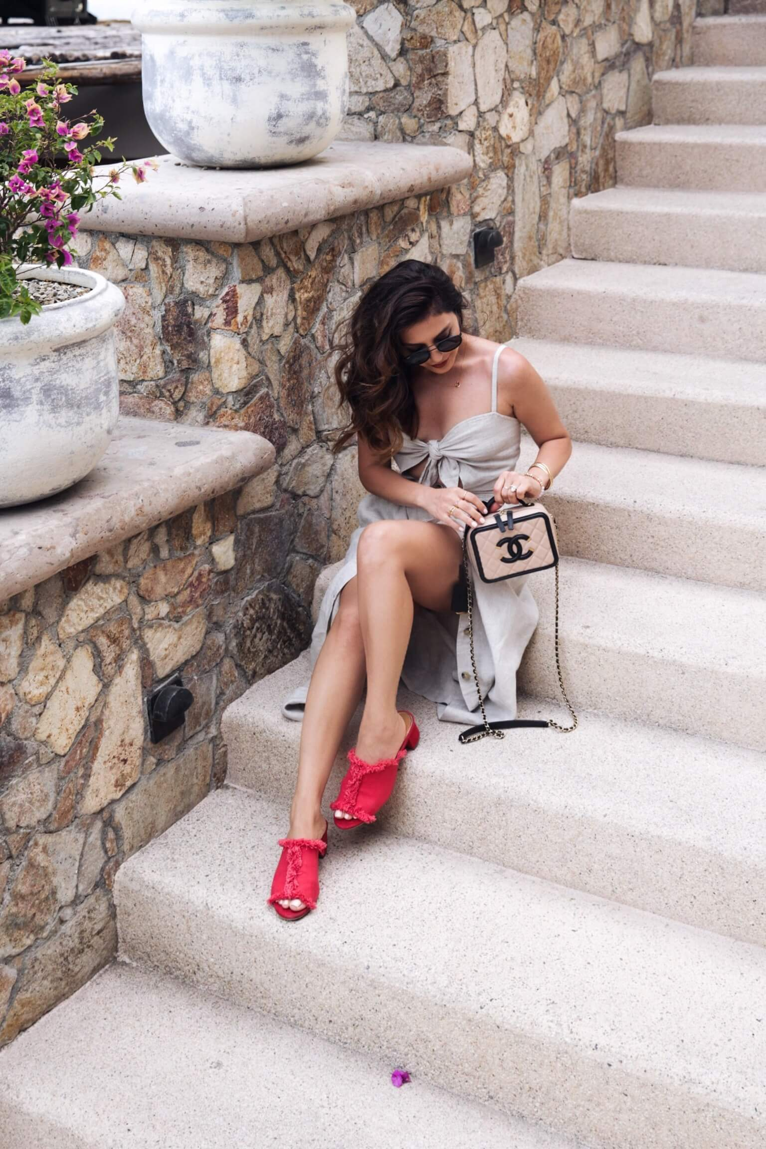 sona gasparian wears a preferct casual wedding guest dress and stylish summer shoes in cabo